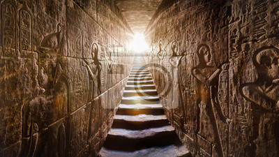 Naklejka Temple of Edfu, Egypt. Passage flanked by two glowing walls full of Egyptian hieroglyphs, illuminated by a warm orange backlight from a door at the end of the stairs.
