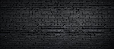 Naklejka Texture of a black painted brick wall as a background or wallpaper