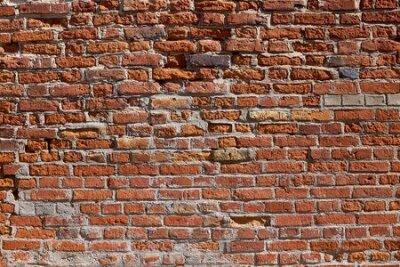 Naklejka Texture of an old brick wall. Old red brick masonry. The brick background.