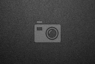 Naklejka Texture of black matte plastic.Black and white matte background.The background is black rough plastic.