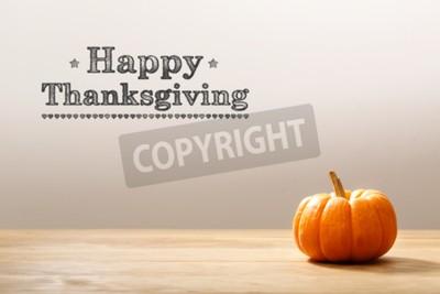 Naklejka Thanksgiving message with a orange small pumpkin