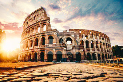 Naklejka The ancient Colosseum in Rome at sunset