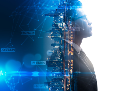 Naklejka The double exposure image of the businessman thinking overlay with cityscape image and futuristic hologram. The concept of modern life, business, city life and internet of things