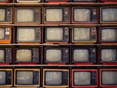 Naklejka The Pattern wall of pile old retro TV bachground