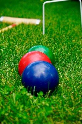 three croquet balls in a row