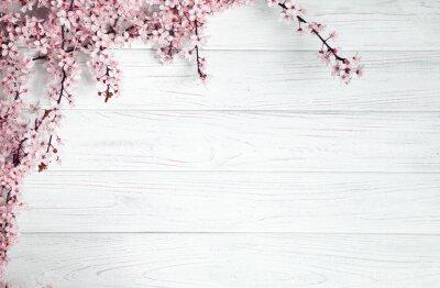 Naklejka tło wiosna. owoce kwiaty na drewnianym stole