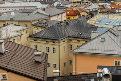 Naklejka top view old town historical street district houses roofs urban landmark photography in European city Salzburg touristic site