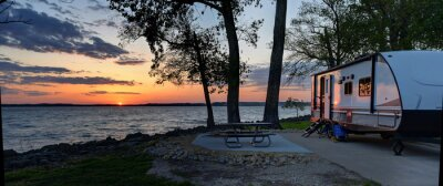 Naklejka Travel trailer camping at sunset by the Mississippi river in Illinois at sunset panorama