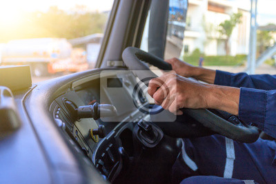 Naklejka Truck driver keeps driving with hands