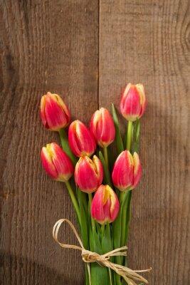 Naklejka tulipani su sfondo di Legno