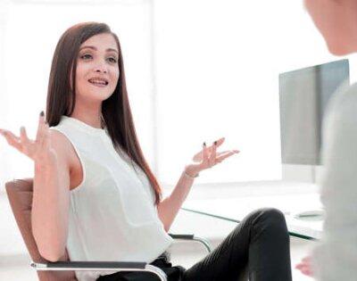 Naklejka two business women talking in the workplace