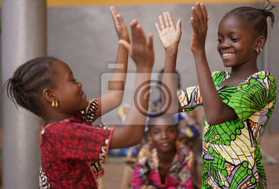 Naklejka Two Little African Girls Performing A Hand Clapping Game