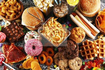 Naklejka Unhealthy products. food bad for figure, skin, heart and teeth.