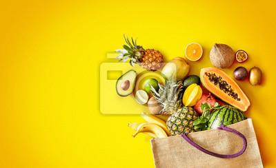 Naklejka Variety of fresh tropical fruit on exotic yellow