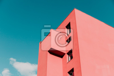 Naklejka View from below on a pink modern house and sky. Vintage pastel colors, minimalist concept.