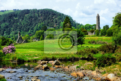 Naklejka View of the historic Glendalough monastic site with ancient round tower and church in Wicklow National Park, Ireland