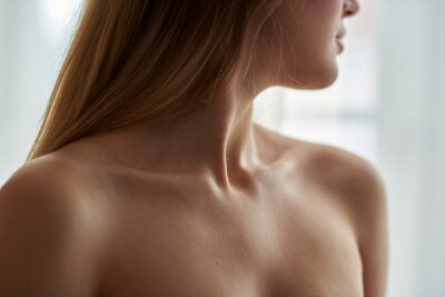Naklejka View on woman's neck, collarbone, breast and shoulders, close-up