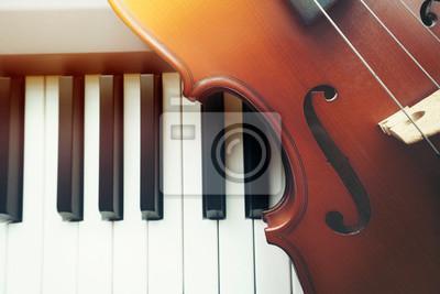 Naklejka Violin on piano keyboard ,top view