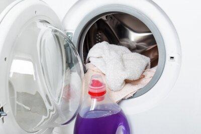 Naklejka Washing machine and laundry detergent gel for washing.