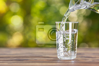 Naklejka water pouring into glass