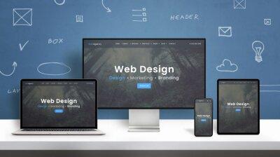 Naklejka Web design studio web site responsive design presentation on computer display, laptop, smart phone and tablet. Blue wall with web design concept elements