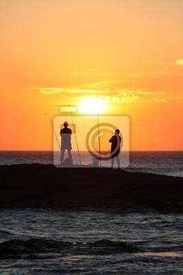 Naklejka Wędkowanie o zachodzie słońca