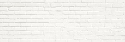 Naklejka White brick wall background. Neutral texture of a flat brick wall close-up.