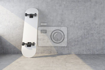 Naklejka white skateboard on concrete wall background