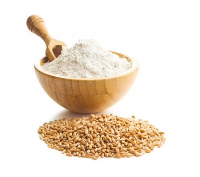 Naklejka Whole grain wheat flour and wheat grains in bowl isolated on white background.