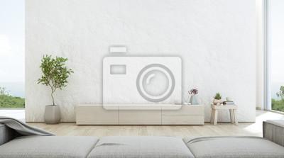 Naklejka Widok na morze salon luksusowego letniego domku na plaży z szafką pod telewizor i drewnianą szafką. Pusty szorstki biały betonowej ściany tło w wakacje domu lub wakacyjnej willi. Hotelowa wnętrza 3d i