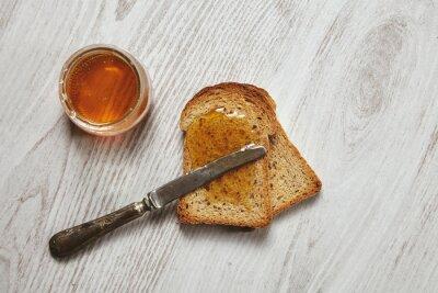 Naklejka Widok z góry dwa tosty z miodem