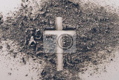 Naklejka widok z góry krzyża kształt z popiołu na biały stół