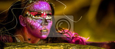 Naklejka Woman in bodypaint playing on the Mangrove beach