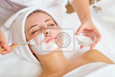 Naklejka Woman in mask on face in spa beauty salon.