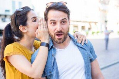 Naklejka Woman is whispering I love you into his boyfriends ear