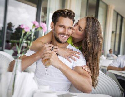 Naklejka Woman kissing handsome man