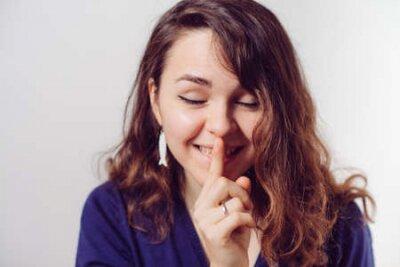 Naklejka woman put finger on her lips