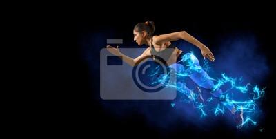 Naklejka woman running on dark background