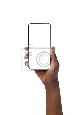 Naklejka Woman's hand holding smartphone with blank screen, isolated on white background