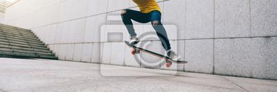Naklejka woman skateboarder legs skateboarding at city