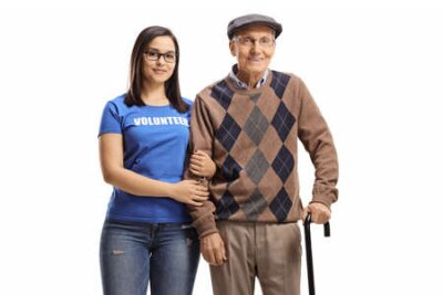 Naklejka Woman volunteer standing with a senior male pensioner with a walking cane isolated on white background
