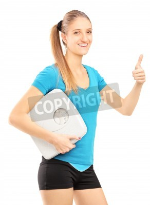Naklejka Woman with a weight scale giving thumb up isolated on white background