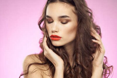 Naklejka Woman with hairstyle and red lips naked shoulders bright makeup attractive look