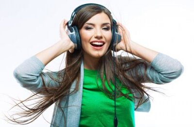 Naklejka Woman with headphones listening music .Music teenager girl dancing against isolated white background