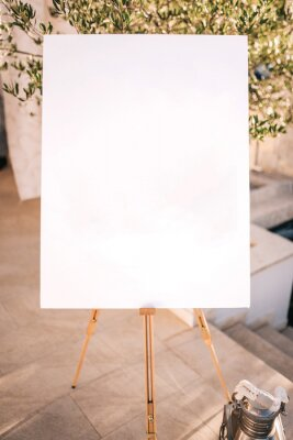 Naklejka Wooden easel with white paper