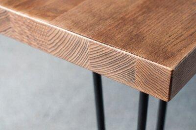 Naklejka Wooden table. Corner of the table. Furniture element. Background.