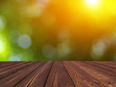 Naklejka wooden table place and green blurred background