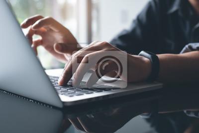 Naklejka Working on laptop computer