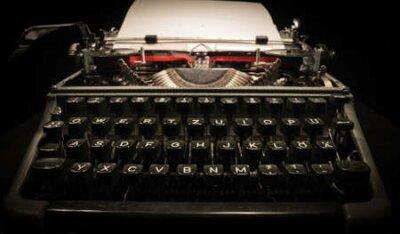 Naklejka Writing a letter on an old typewriter - very nostalgic