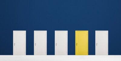 Naklejka Yellow door among white ones in room. Concept of choice